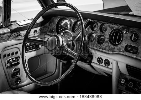BERLIN GERMANY - MAY 17 2014: Interior of the driver's seat of the car Rolls-Royce Corniche I Cabriolet. Black and white. 27th Oldtimer Day Berlin - Brandenburg