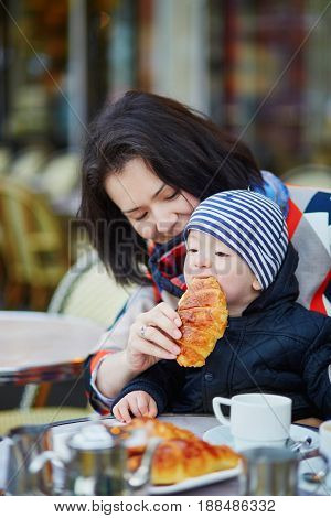Happy Family Of Two In Parisian Outdoor Cafe