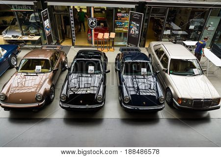 BERLIN GERMANY - MAY 17 2014: Various retro cars of Porsche and Mercedes-Benz at the exhibition. Top view. 27th Oldtimer Day Berlin - Brandenburg