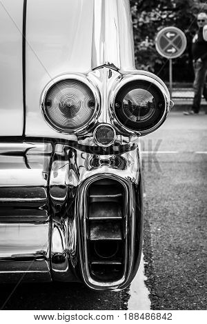 BERLIN GERMANY - MAY 17 2014: The rear brake lights of oldtimer Cadillac Series 62 (Fifth generation). Black and white. 27th Oldtimer Day Berlin - Brandenburg