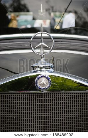 BERLIN GERMANY - MAY 17 2014: Hood ornament of the luxury car Mercedes-Benz Typ 290 (W18) 1933. Close up. 27th Oldtimer Day Berlin - Brandenburg