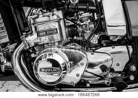 BERLIN GERMANY - MAY 17 2014: Engione of the first Japanese motorcycle with a liquid-cooled engine Suzuki GT750. Black and white. 27th Oldtimer Day Berlin - Brandenburg