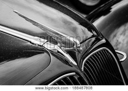 BERLIN GERMANY - MAY 17 2014: Hood ornament of the mid-size luxury car Citroen Traction Avant. Black and white. 27th Oldtimer Day Berlin - Brandenburg