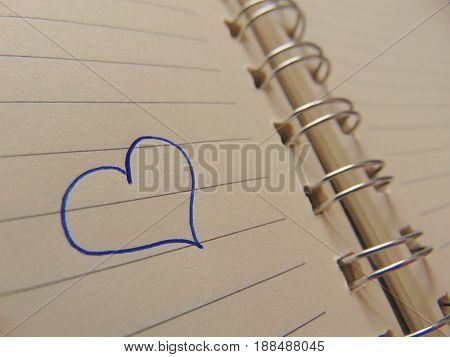 Cute heart drawn with ballpen in notebook