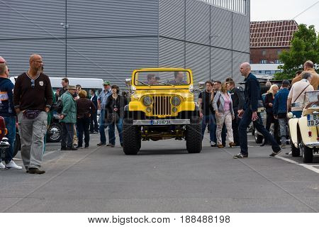BERLIN GERMANY - MAY 17 2014: A compact four-wheel drive off-road and sport utility vehicle (SUV) Jeep Wrangler. 27th Oldtimer Day Berlin - Brandenburg