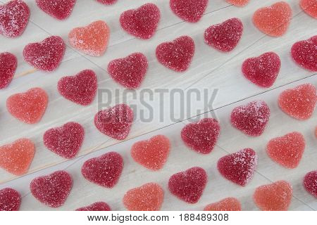 Angled Rows Of Dark Red And Pink Gummy Hearts With Empty Text Space