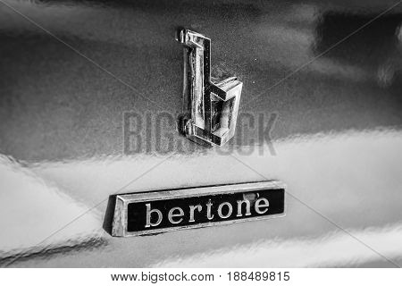 BERLIN GERMANY - MAY 17 2014: Emblem of the car styling studio Bertone on the sports car Maserati Khamsin (Tipo 120). Black and white. 27th Oldtimer Day Berlin - Brandenburg
