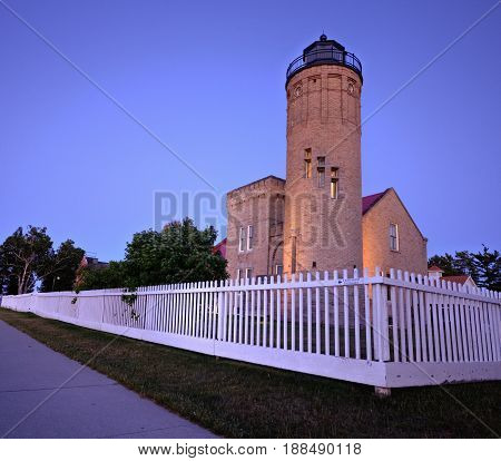 Mackinaw Point Lighthouse. Twilight descends on the gothic style Mackinaw City Lighthouse on the Straits of Mackinaw