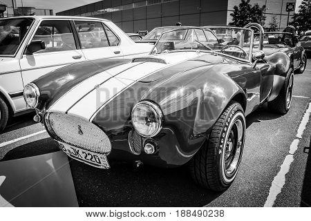 BERLIN GERMANY - MAY 17 2014: Replica sports car Shelby AC Cobra. Manufactured by Saier Automobilbau. Black and white. 27th Oldtimer Day Berlin - Brandenburg