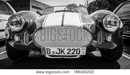 BERLIN GERMANY - MAY 17 2014: Replica sports car Shelby AC Cobra. Manufactured by Saier Automobilbau. Black and white. 27th Oldtimer Day Berlin - Brandenburg
