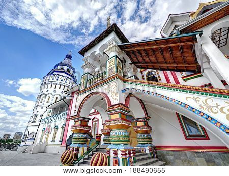Wide angle view on Izmailovsky Kremlin rebuild imperial manor of XVII century. White stone manor architecture. Classic traditional Russian ornaments painting wooden elements of blue white red colors