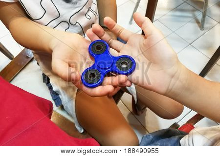 Underaged Kids Playing The Fidget Spinner. Maybe Hazardous To Kids.