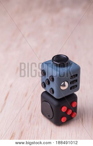 Fidget Cube, The Stress Relieving Cube On Table Top