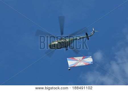 MOSCOW, MAY 9, 2010: Green helicopter Mi-8 with Russian army flag above Red Square on celebration of Great victory 65th anniversary. USSR victory in Second World War. 9 May Victory day