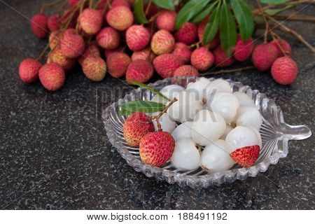 Litchi fruits. Fresh juicy lychee fruit on a glass plate. Organic leechee sweet fruit. Organic fruit concept. Exotic tropical litschi berry. Peeled lychee fruit.