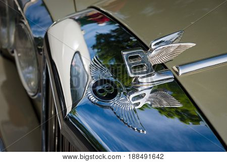 BERLIN GERMANY - MAY 17 2014: Hood ornament of the full-size luxury car Bentley T2. 27th Oldtimer Day Berlin - Brandenburg