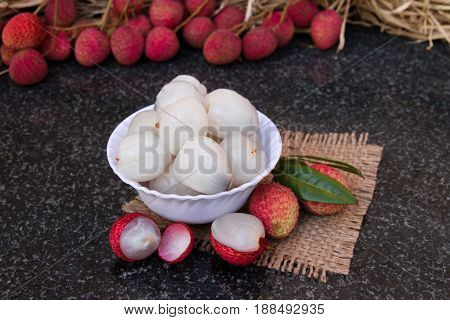 Litchi fruits. Fresh juicy lychee fruit on a ceramic plate. Organic leechee sweet fruit. Organic fruit concept. Exotic tropical litschi berry. Peeled lychee fruit.