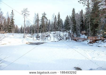 Winter frozen waterfall in Karelia Russia winter forest and river