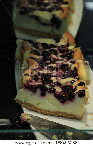 Fresh made forest fruit cheesecake in a restaurant counter