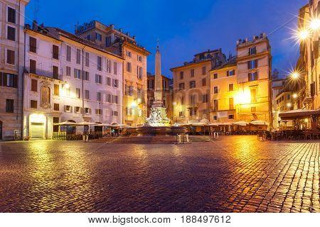 Fountain with obelisk at Piazza della Rotonda, at night, Rome, Italy