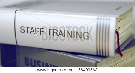 Book in the Pile with the Title on the Spine Staff Training. Staff Training. Book Title on the Spine. Blurred Image. Selective focus. 3D Illustration.