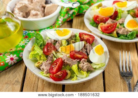 Salad with canned cod liver tomato olives lettuce and egg