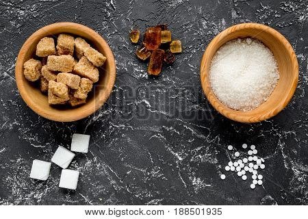 lumps and sanding sugar for cooking sweets on kitchen table background top view