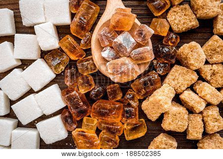 lumps of sugar for cooking sweets on kitchen table background top view pattern