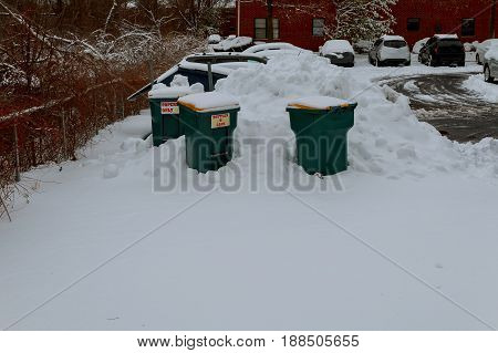 Snowbound garbage bins Waste bin with snow winter photo