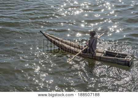 The Fisherman Goes To Sea On A Traditional Peruvian Small Reed Boats (caballitos De Totora) In Pimen