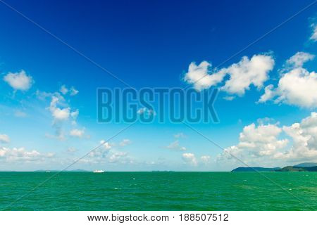Beautiful Tropical Sea Under The Blue Sky With Green Islands