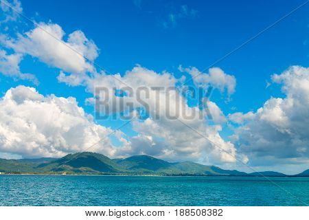 Sunny Day With Blue Cloudy Sky At Tropical Green Island