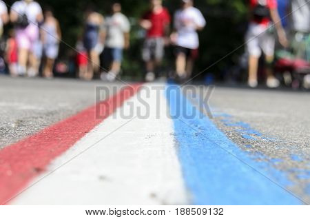 Bristol Rhode Island USA - July 4 2011: Red white and blue stripe marks Bristol parade route
