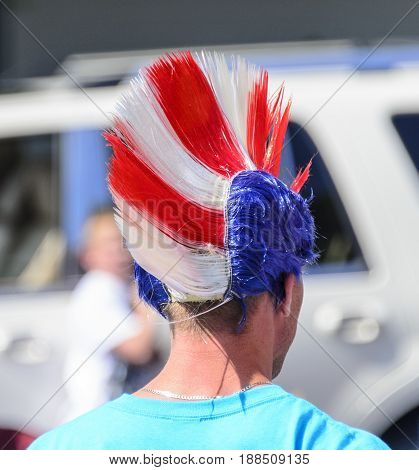 Bristol Rhode Island USA - July 4 2011: Red white and blue mohawk spectator headgear at parade