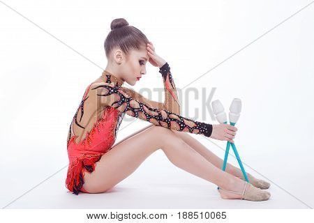 Tired athlete with a mace sits on the floor