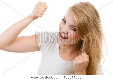 Success achievement winning concept. Happy positive blonde woman clenching fists out of joy.