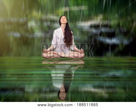 Beautiful girl in Lotus position on the water surface