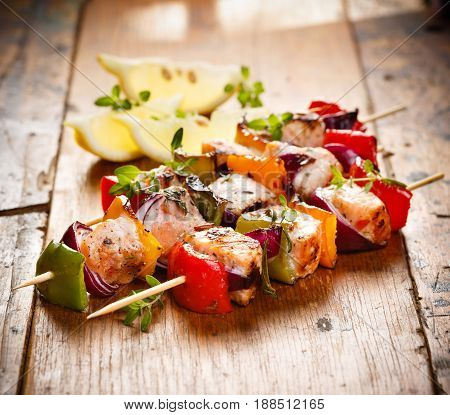 Skewers of grilled salmon, onions and peppers in herb lemon marinade
