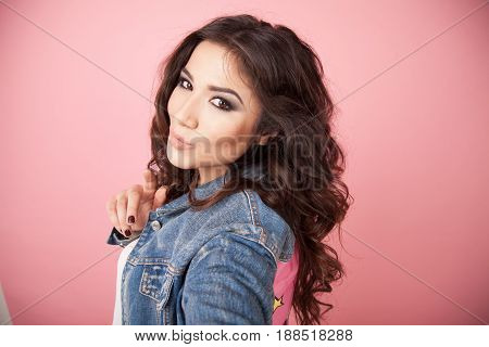 beautiful girl posing and photographing himself on the phone