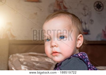 Thoughtful Look Of A Small Child Looking Out The Window.