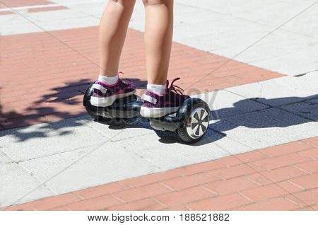 A Girl Riding A Self Balancing Scotter Hoverboard
