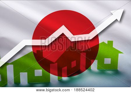 The flag of Japon and the rising prices of real estate. Rental prices are rising up in the tourist season. Home and white arrow up on a flag background.