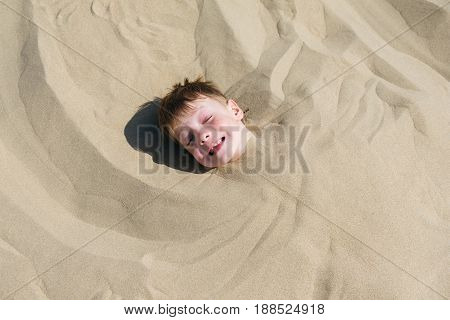 Playful kids on summer beach sand vacation having fun and happy time.