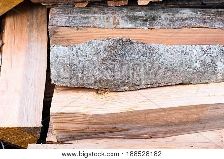 Neatly Stacked Firewood From Alder Wood Backgrownd