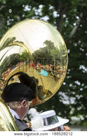 Bristol Rhode Island USA - July 4 2011: Tuba reflecting spectators at Independence Day parade in Bristol Rhode Island
