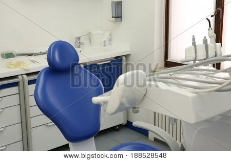 Dental Clinic Room With Blue Chair And Instrumentation For Denta
