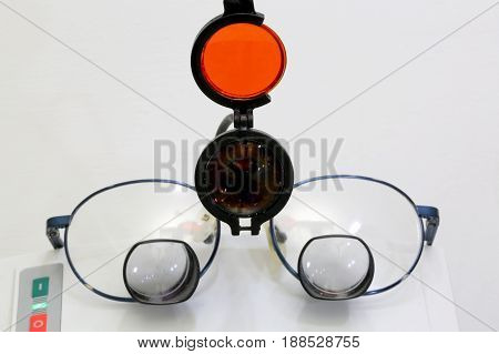 Special Glasses With Four Lenses And An Infrared Beacon For Surg