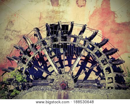 Broken Wheel Of An Old Abandoned Water Mill With Vintage Effect