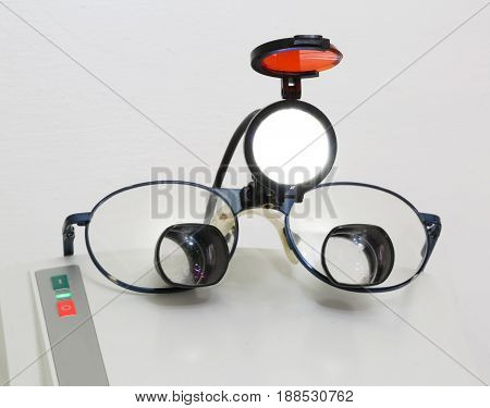 Glasses With Four Lenses And An Infrared Spotlight Light For Sur