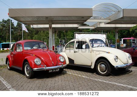Wageningen, The Netherlands - May 29, 2017: Two Volkswagen Beetles parked on public parking lots in the city of Wageningen. Nobody in the vehicle. The VW T1 is also known as Beetle, Bug and Kafer.